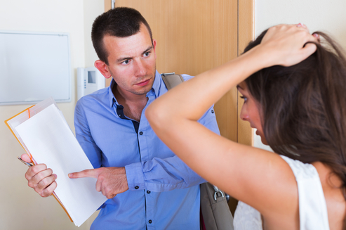Mark Roemer image of a landlord showing a client the rules of living on the property
