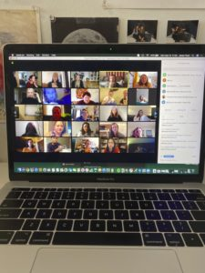 Mark Roemer image of a laptop with a group of people in a video chat