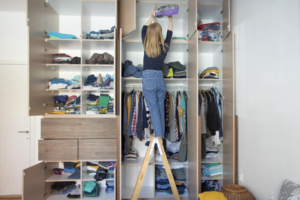 Mark Roemer image of a woman cleaning out her closet
