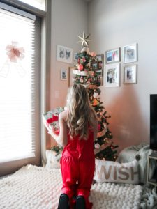 Mark Roemer image of a person on their knees decorating the tree